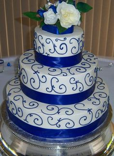 white & royal blue wedding cake