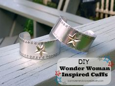 Channel your inner crime-fighter with these Silver Superhero Cuffs. This simple tutorial teaches beginners how to make a cuff bracelet from aluminum. With a few star stamps, a dash of silver ink, and a bit of bending, you can make your own superhero inspired jewelry.