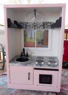 DIY:: Super Cute Play Kitchen using an upcycled entertainment center!