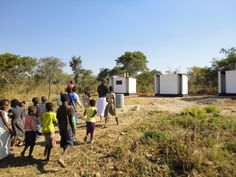 17. The pupils of Kinnertone School are led out to view the completed latrines and are told which are for staff use, and which for boys and girls.