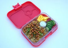 #MeatlessMonday #Yumbox lunch in the new Yumbox Panino in Anguria Pink. Here I packed 2.5 cups of spiced rice pilaf, masala chickpeas, fresh mango slices and cucumbers with yogurt dip.