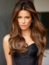 Brunette hair color with caramel highlights.