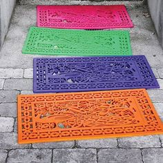 Buy a rubber doormat and spray paint it any color