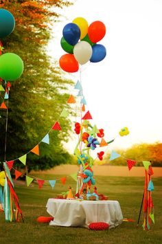 "fabric bunting hung from 36"" balloons or a cluster of standard balloons...stake in the ground with golf tees!"