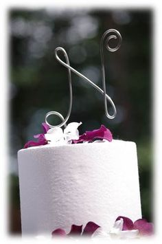 Wedding cake topper sweet <3 could be the first letter of the grooms last name :)