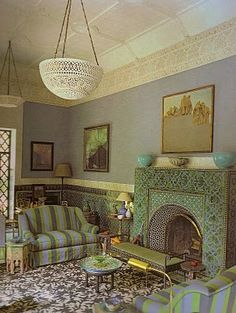 Moroccan inspired green living room and firelplace