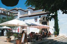 Sidewalk cafe in Granada's Albaicin quarter