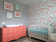 Herringbone hand-stenciled accent wall + coral painted vintage dresser + touches of gold = nursery love! #nursery #herringbone
