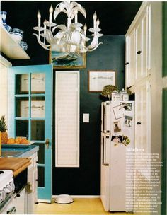 Love the black wall and turquoise door.