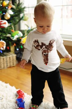 Use baby's hand and foot prints to make this reindeer tshirt. Tutorial on Rust & Sunshine