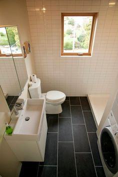Bathroom with recycled ceramic tile floor inside Greenfab's 1300 Series Model Home.