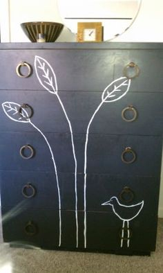 antique, charcoal-colored, upcycled dresser with bird and plant illustration; brass pulls Love it!