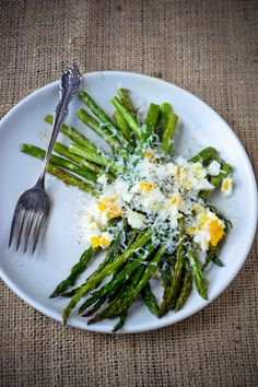 - For more information visit: http://www.scalingbackblog.com/savory-bites/roasted-asparagus-with-eggs-and-parmesan/