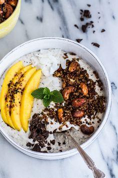 Coconut Banana Oats Smoothie Bowl with Crunchy Black Sesame Quinoa Cereal + Mango | halfbakedharvest.com