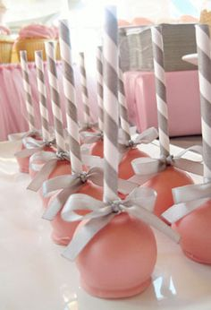 These cake pops remind me of baby rattles. Click through for a description and pictures of a beautiful pink and grey butterfly ballerina girl baby shower.