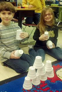 Stacking cups to teach sight words and math