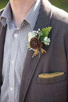 great rustic boutonniere, photo by Buena Lane, bout by Lilify http://ruffledblog.com/western-nomadic-styled-shoot #boutonnieres #groom #wedding
