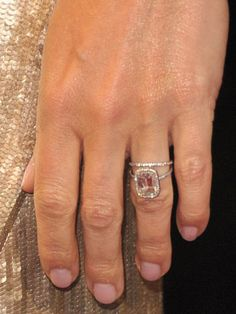Gwyneth Paltrow wedding ring. A large slightly pink emerald cut diamond on an ultra thin platinum band with pave diamonds.
