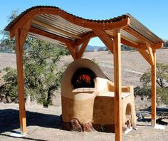 """Cob Oven by SGNB.com, via Flickr - I like the """"shelf"""" beside it. It would be cool to do on both sides."""