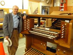 Ed Stout in the organ shop, in front of the partially reassembled console of the St. Paul's Burlingame Skinner we just finished rebuilding.
