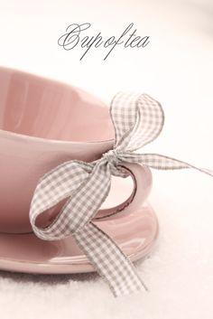 Pink teacup. Gingham ribbon.