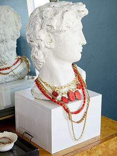 A Greco-Roman plaster bust from a flea market can be made into a fun jewelry display by adding a white-painted wood box.