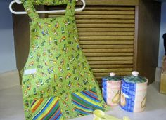 A fun apron - reversible Montessori syle featuring the veggie tales characters...
