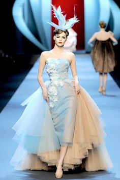 """Christian Dior, S/S 2011. """"Galliano played on the 'Ultimate Dior Muse': Wasp-waisted, 50's silhouettes; High-low (shorter in front, longer in back) dresses; Grace Kelly in Monaco-meets-Princess Soraya of Iran."""""""