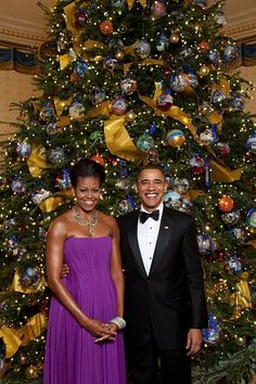 """Barak and Michelle Obama, 2009  It is said that Michelle Obama  told Oprah during the White House  Christmas special that they had sent out blank ball ornaments to """"nonprofits and such"""" where they were decorated and sent back."""