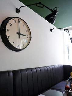 A large modern clock really makes a statement. Love!