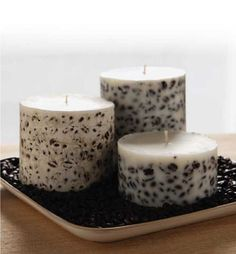 DIY Make over leftover candles by embedding fresh wax, coffee beans and other embellishments into the sides.
