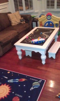Playroom chalkboard table!  Coffee table into children's table with mini benches.