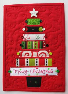 Christmas tree mug rug--what an adorable way to use your holiday scraps! By mamacjt via Flickr.