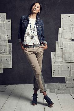 Anthropologie   Casual wear with a touch of girly flair : Denim jacket with a creamy lace tank and cuffed chinos  Found on anthropologie.com
