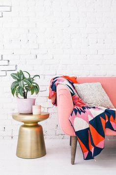 Love this pink couch and colorful throw.
