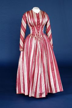 Wedding dress in red and pale pink striped silk damask. English, circa 1849