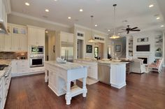 Open floor plan with double islands. Thermador kitchen appliances. Built by Javic Homes in Tampa.