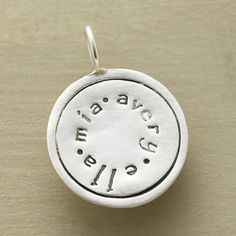 Lightly oxidized, textured sterling silver stamped with up to 15 characters, including spacer dots.