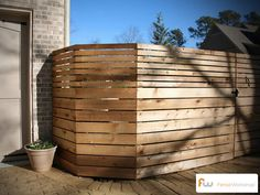 A contemporary wood privacy fence style.