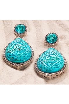Carved turquoise, blue topaz, and white sapphire earrings have rich texture.    Rarities: Fine Jewelry by Carol Brodie, $500; HSN.com