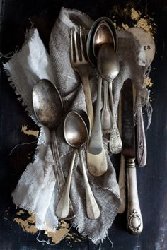 Antique flatware, never matches but always comfortable.
