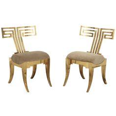 Brass Klismos Chairs.
