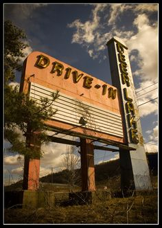 go to a drive-in theatre to see a movie.