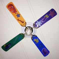Ceiling fan that we painted the blades using paint from Home Depot. We used Treasure Isle, Orange Zest, Deep Orchid and Brilliant Sea. Then we used Disney's Finding Nemo Self Stick Room Appliqués From Home Depot to finish the look.