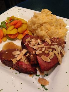 Pork Tenderloin w/an Apple Wine Sauce - tenderloin rubbed with ground cinnamon and sage roasted, topped with almonds and drizzled with a Mackinaw Trails wine sauce served vegetables and your choice of potato soup or salad.