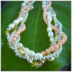 Peach with gray - kiss from a rose crystal mix, freshwater pearls, pink coral and light grey Swarovski crystal pearls, and sterling silver.