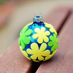 little kid craft foam stickers and plastic christmas ornament.