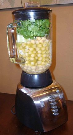 Awesome Hummus Recipe 2 cans garbanzo beans (chickpeas), drained 1/2 cup tahini 1/2 cup extra virgin olive oil juice of two lemons 1/2 bunch cilantro 1/2 cucumber, peeled and cubed a dash of pickle juice 1 tsp. garlic powder 1/2 tsp. each salt and paprika