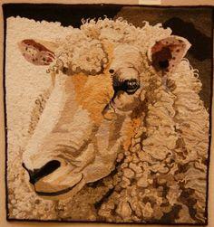 Sheep face by Patty Yoder. She made many many sheep rugs.