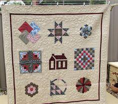my first quilt, a sampler of hand pieced blocks